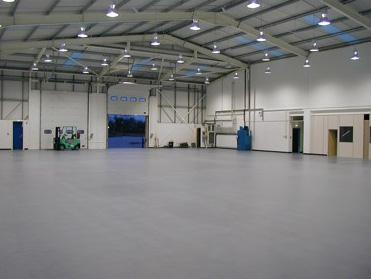 stonlok pvc flooring in airplane hanger